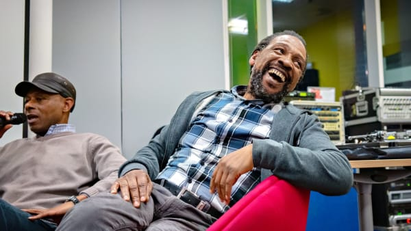 Man laughing on chair at Poet in the City Collections in Verse event in Leeds